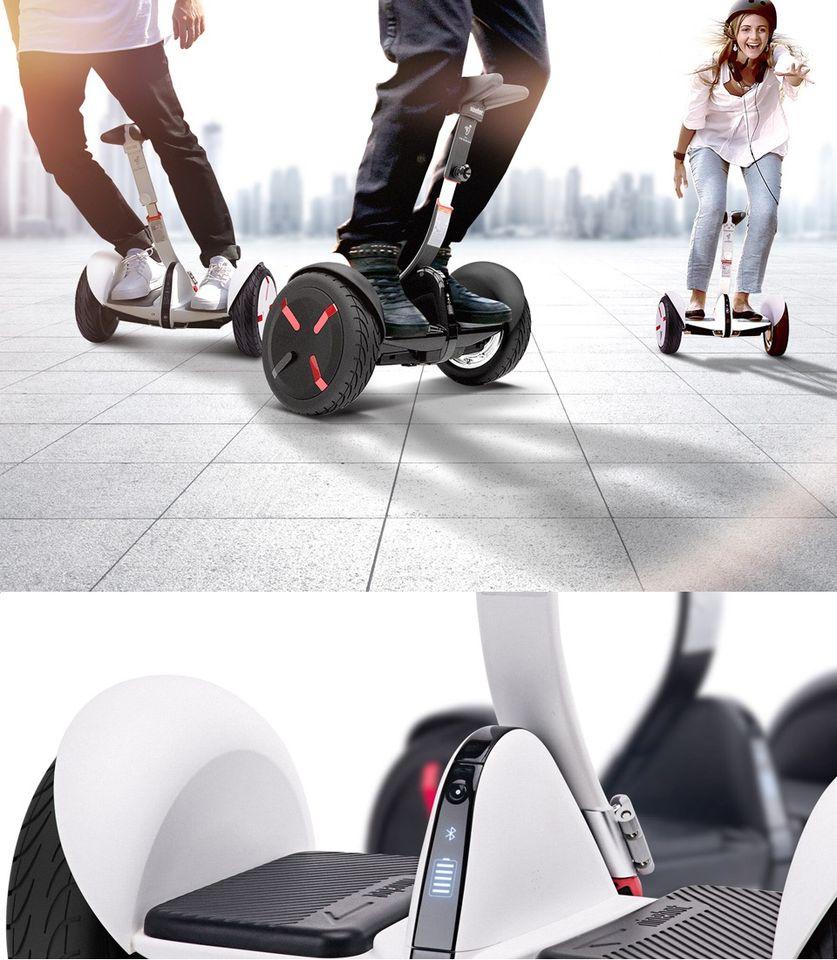 Самобалансирующейся скутер Ninebot mini Pro молодые люди катаются на гироскутере
